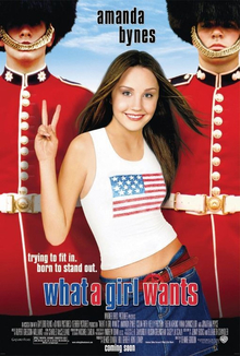 What a Girl Wants poster - Amanda Bynes throws up a peace sign while standing between two guards in bearskin hats.